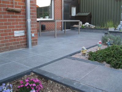 BOUWBEDRIJF DE BACKER BVBA - Tegels in keramiek - Oprit en terras leggen - Realisaties